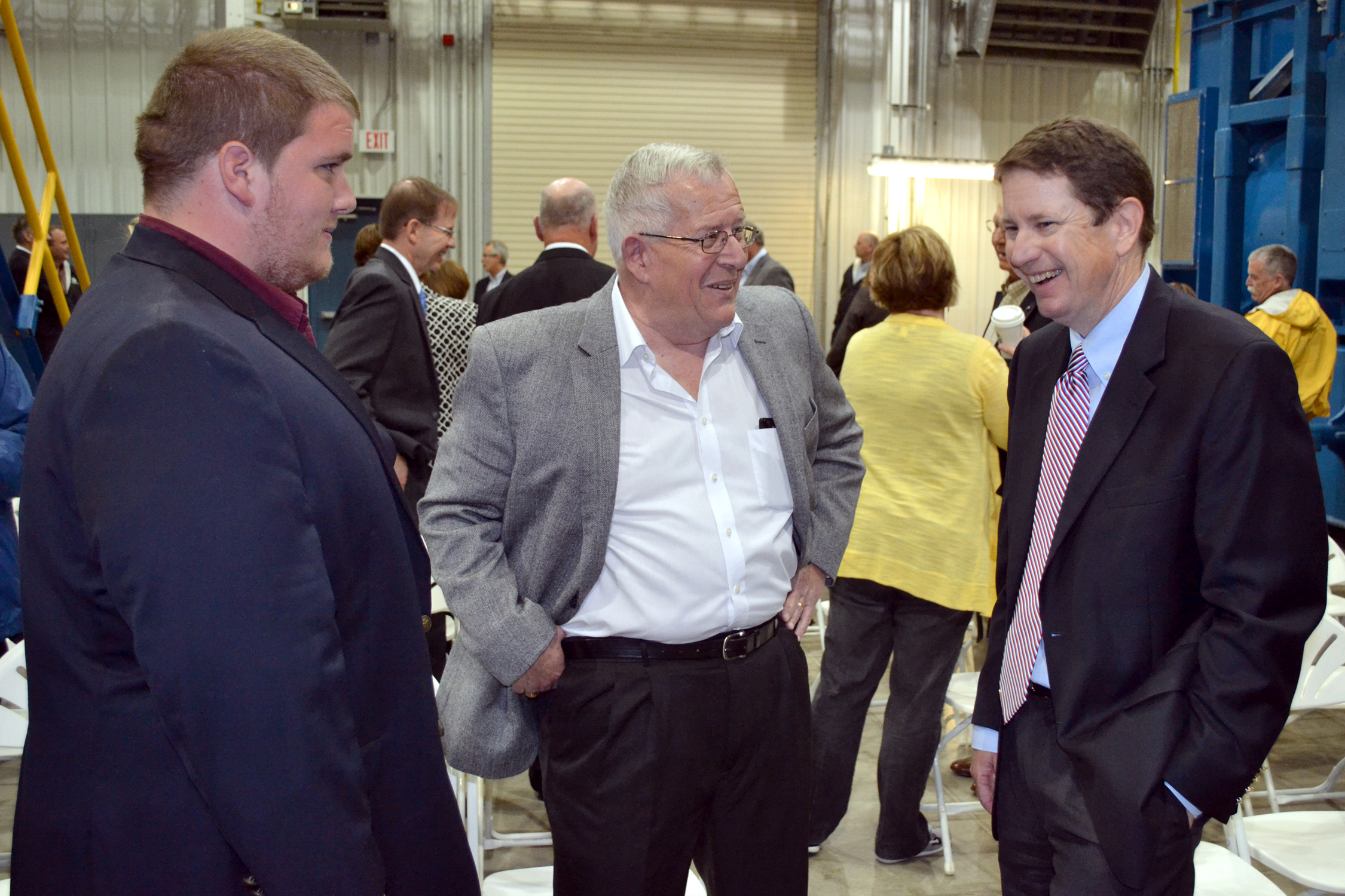 (L to R) Daniel Goodman, grandson of the late Jack Goodman, and his father Marc Goodman, share a laugh with Stuart Lowry, CEO of Sunflower Electric, at the Goodman Energy Center dedication.
