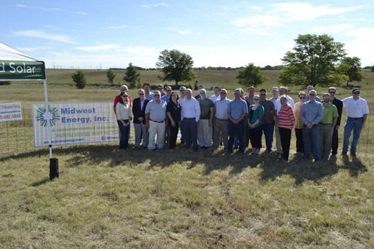 The group gathers in front of what in a few weeks will be transformed into Kansas' largest solar array!