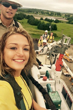Kirsten Zerr, a senior at Wheatland High School, takes a ride in a bucket lift with a lineman from Kaw Valley Electric Cooperative outside of Topeka on June 19.
