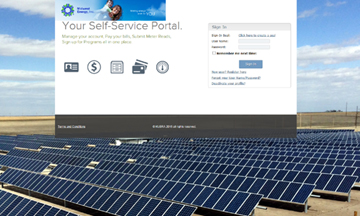 A screen shot of the new self-service portal page is overlaid on a photo of the 3,960 solar panels at the Midwest Energy Community Solar Array in Colby, Kan.