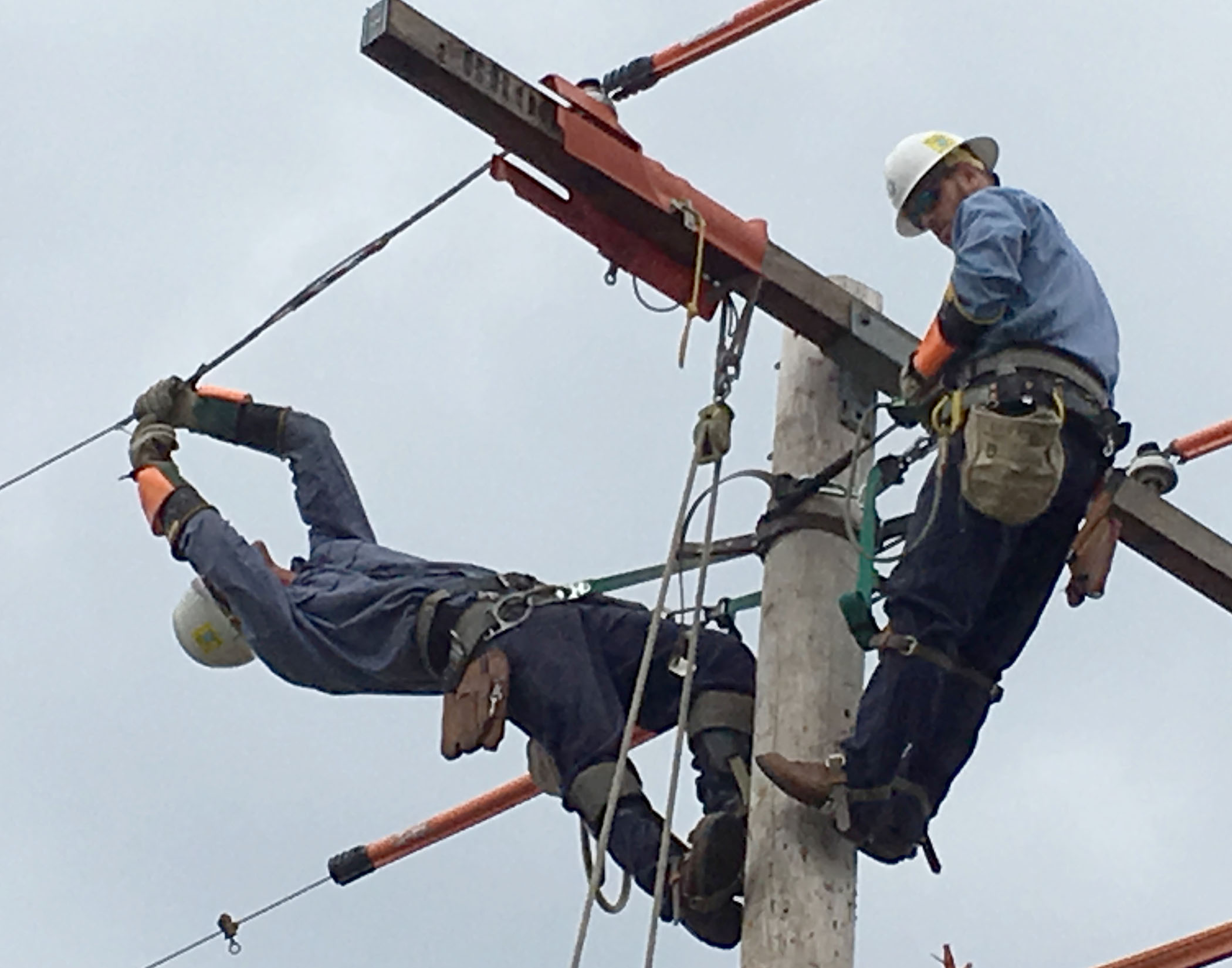 A photo of Great Bend Journeyman team members Alex Breeding and Nathan Stryker work on replacing a wire tie at the International Lineman's Rodeo in Bonner Springs, Oct. 14.