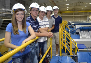 (From left) Rebecca Bange of Rexford joins Cheylin High School student Jacob Brubaker of Bird City, Seth Hachmeister of Natoma, Ross Frame of Kinsley and Matt Mindrup of Hays, in touring Midwest Energy's Goodman Energy Center in Hays on June 12.  The group joined other students from Kansas to represent the state at the 2014 Youth Tour in Washington, D.C.