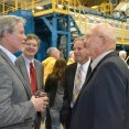 (L to R foreground) Gary Moss, member of Midwest Energy's Board of Directors, talks with Senator Ralph Ostmeyer (R-Grinnell) at the Goodman Energy Center dedication, while Bill Dowling, Midwest Energy's VP for Engineering and Energy Supply, and Rep. Rick Billinger (R-Goodland) listen.