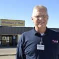 Mark Watkins, owner of Heartland Foods in Oakley, calls Midwest Energy