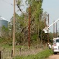 Midwest Energy crews replace poles near Rush Center that were damaged during a tornado April 14. A total of 526 poles and 24 miles of line were replaced as a result of the storm which produced 121 tornadoes throughout Kansas, Nebraska, Iowa, Oklahoma and Texas. No fatalities were reported in Kansas, though six were killed in Woodward, Okla.