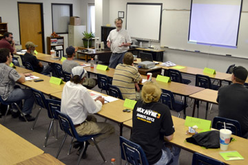 Steve Swartz, Business and Manufacturing Technology instructor from Hutchinson Community College, goes over testing procedures with students enrolled in the Workforce AID program at NCK Tech in Hays.