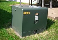 Photo of a pad-mounted transformer in the yard of a Midwest Energy member.