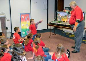 Brian Dreiling, Midwest Energy employee, uses a tabletop electric and gas safety demonstration kit to educate elementary-aged children about electricity and gas.